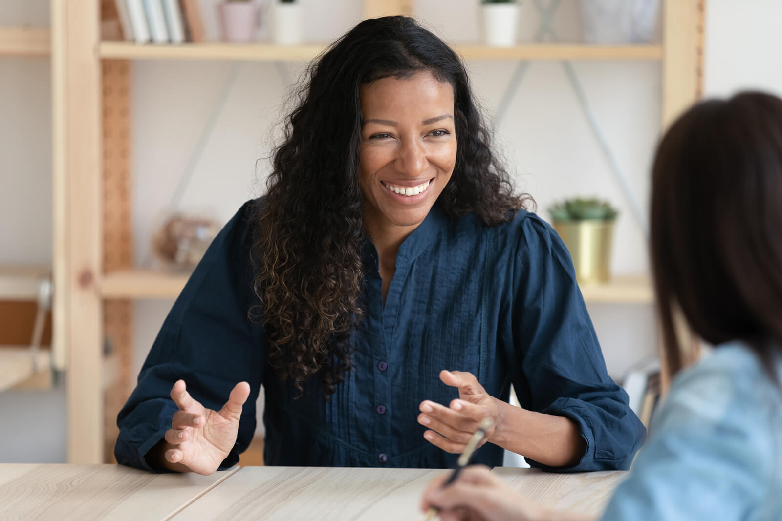 woman smiling while on interview