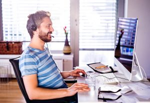 Man happily working at a computer